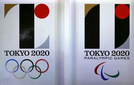 Tokyo 2020 Olympic and Paralympic games emblems are seen during an unveiling event at Tokyo Metropolitan Government Building in Tokyo
