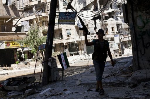 A Syrian rebel walks in a heavily damaged street in the Salaheddin district of the northern city of Aleppo on September 6. Syrian filmmaker Tamer al-Awam, 34, has been killed in the northern city of Aleppo, the opposition Syrian National Council said on Sunday