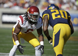 Josh Shaw lines up against California defensive back Isaac Lapite during a 2013 game. (AP)