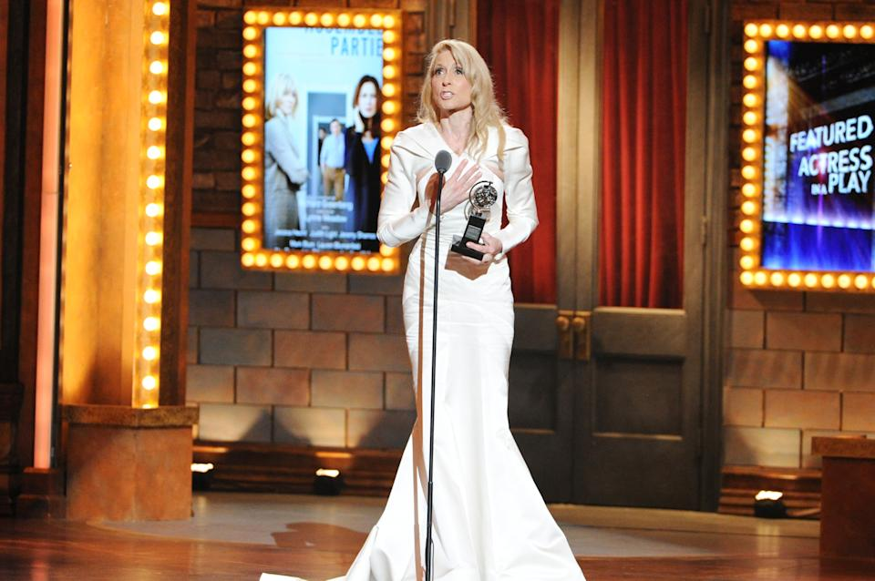 "Actress Judith Light accepts the award for Best Performance by an actress in a featured role in a play for her role in ""The Assembled Parties,"" at the 67th Annual Tony Awards, on Sunday, June 9, 2013 in New York.  (Photo by Evan Agostini/Invision/AP)"