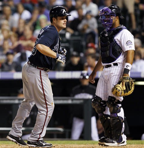 Jones drives in 5 in Braves' 13-9 win over Rockies