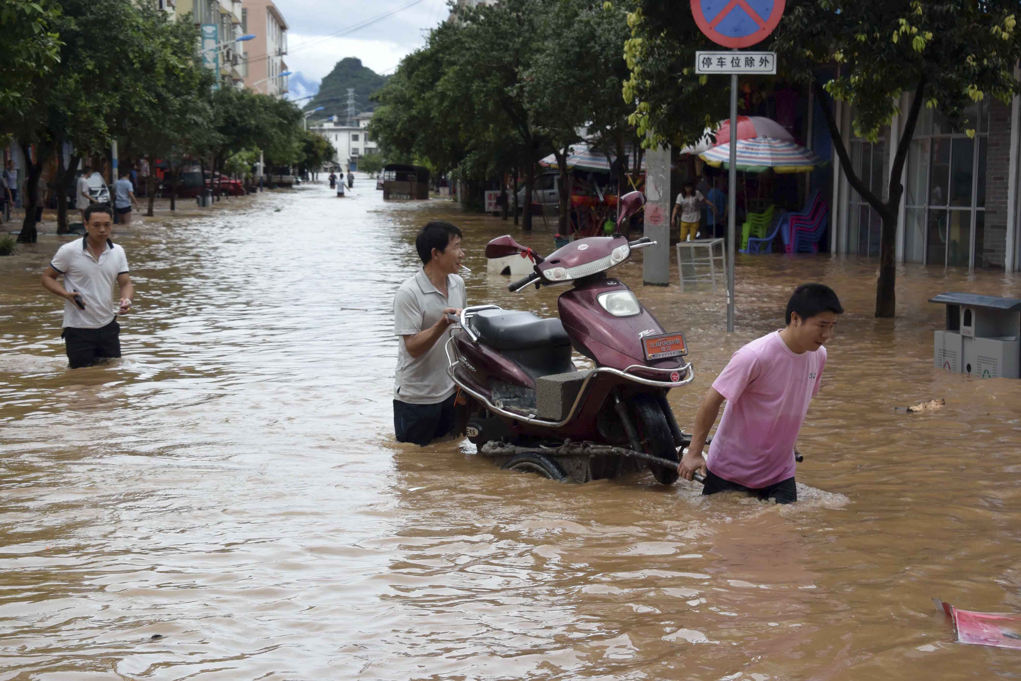 57 dead in China floods, including 2 kids on overloaded bus