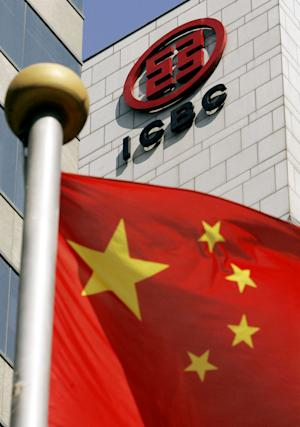 FILE - In this Oct. 27, 2006 file photo, the Chinese national flag stands near a branch office of the Industrial and Commercial Bank of China at the Shanghai Stock Exchange in Shanghai, China. (AP Photo/Eugene Hoshiko, File)