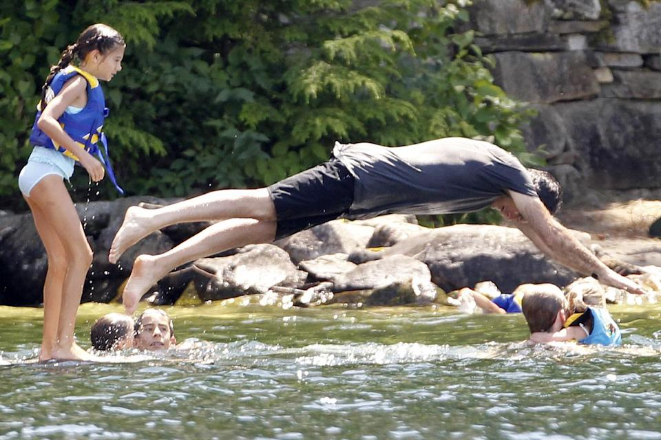 Republican presidential candidate, former Massachusetts Gov. Mitt Romney dives into Lake Winnipesaukee at Winter Harbor in Wolfeboro, N.H., Friday, July 6, 2012, as he continues his vacation with his family from the campaign trail. (AP Photo/Charles Dharapak)