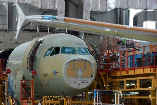 <p>An Airbus A320 plane under construction on the assembly line of Airbus factory in the Chinese port city of Tianjin on June 13. Airbus planes built in the Chinese factory will be sold only to Chinese clients, the European plane maker has said, although a leasing exception could see aircraft end up with foreign airlines.</p>