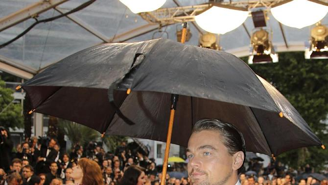 Actor Leonardo DiCaprio arrives for the opening ceremony and the screening of The Great Gatsby at the 66th international film festival, in Cannes, southern France, Wednesday, May 15, 2013. (AP Photo/Lionel Cironneau)
