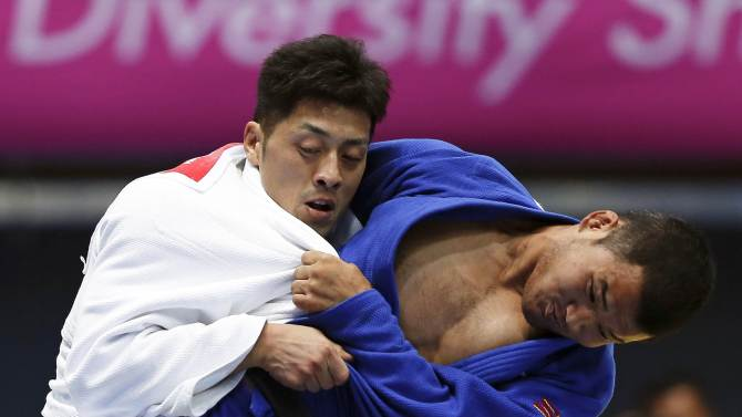 Nagashima competes with Nyamsuren during their men's team bronze medal judo contest at Dowon Gymnasium during the 17th Asian Games in Incheon