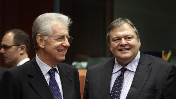 Greek Finance Minister Evangelos Venizelos, right, speaks with Italian Prime Minister Mario Monti during a meeting of EU finance ministers in Brussels on Monday, Jan. 23, 2012. European finance ministers will try on Monday to give new momentum to talks on a Greek debt relief deal that is crucial to avoid a default, but a European diplomat warned that a final agreement may have to wait until a leaders' summit next week. (AP Photo/Virginia Mayo)