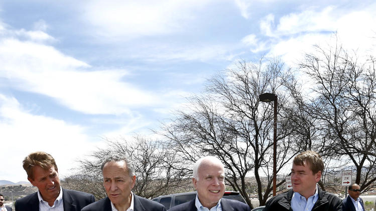 From left, Sen. Jeff Flake, R-Ariz., Sen. Chuck Schumer, D-NY, Sen. John McCain, R-Ariz., and Sen. Michael Bennett, D-Colo, arrive at a news conference after their tour of the Mexico border with the United States on Wednesday, March 27, 2013, in Nogales, Ariz.  The senators are part of a larger group of legislators shaping and negotiating details of an immigration reform package vowed Wednesday to make the legislation public when Congress reconvenes next month. (AP Photo/Ross D. Franklin)