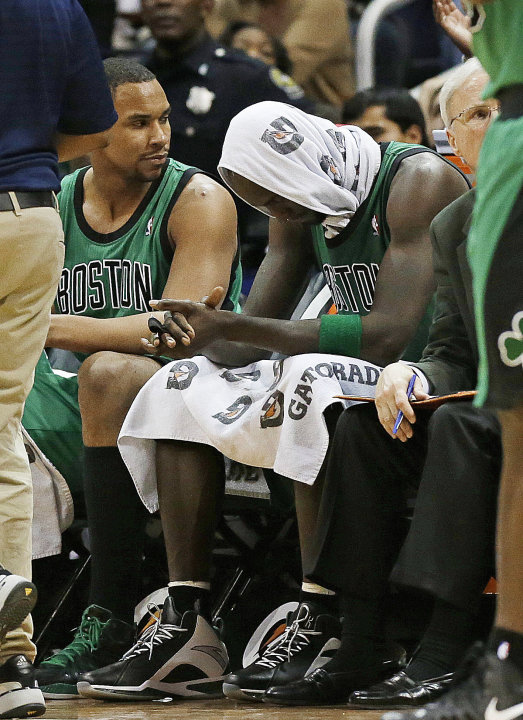 Boston Celtics forward Kevin Garnett sits on the bench after fouling out in the in the second overtime of an NBA basketball game against the Atlanta Hawks, Friday, Jan. 25, 2013, in Atlanta. Atlanta w