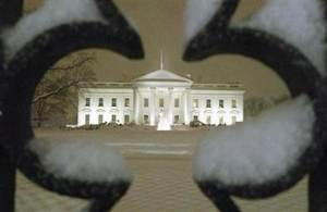 A view of the White House as snow begins to fall during expected blizzard in Washington DC