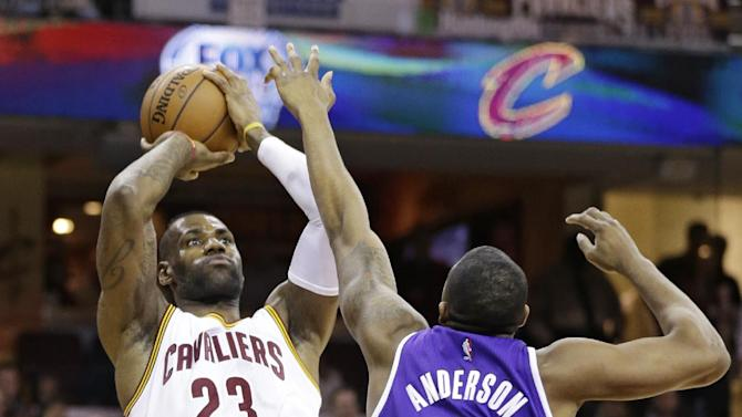 Cleveland Cavaliers' LeBron James (23) shoots over Sacramento Kings' James Anderson (5) in the first half of an NBA basketball game Monday, Feb. 8, 2016, in Cleveland. (AP Photo/Tony Dejak)
