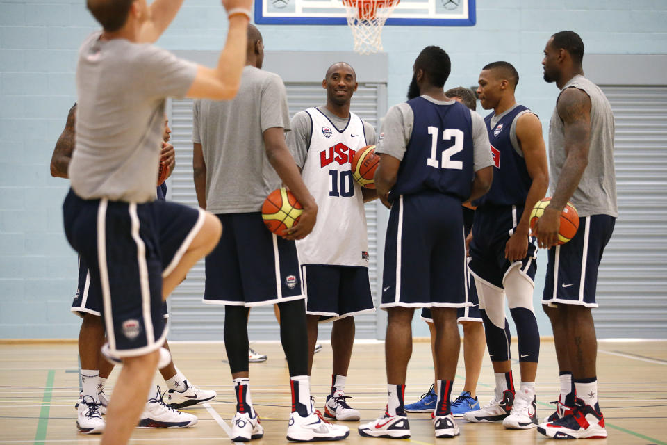 United States players, from right, LeBron James, Russell Westbrook, James Harden (12), Kobe Bryant (10) and Kevin Durant gather for a men's team basketball practice at the 2012 Summer Olympics, Saturday, July 28, 2012, in London. (AP Photo/Jae C. Hong)