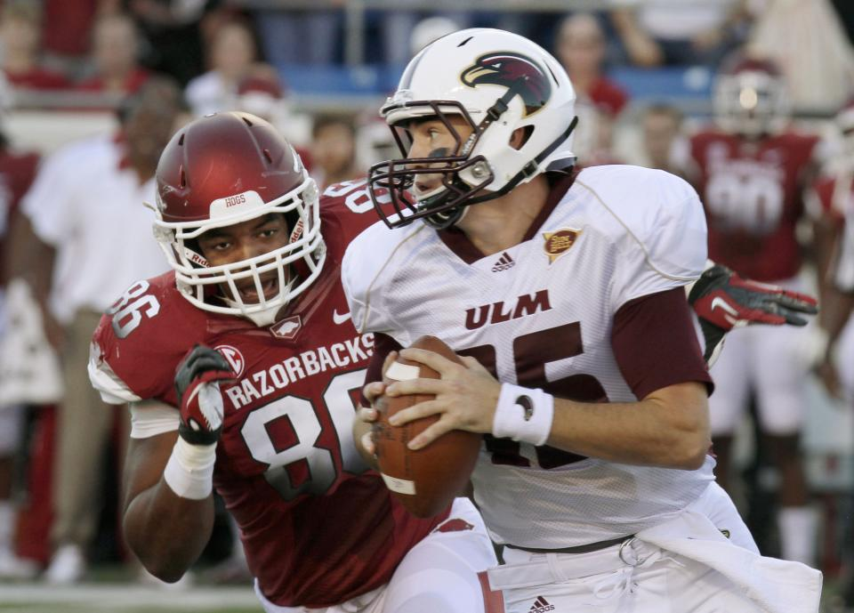 Arkansas defensive end Trey Flowers (86) pressures Louisiana Monroe quarterback Kolton Browning (15) during the first quarter of an NCAA college football game in Little Rock, Ark., Saturday, Sept. 8, 2012. (AP Photo/Danny Johnston)