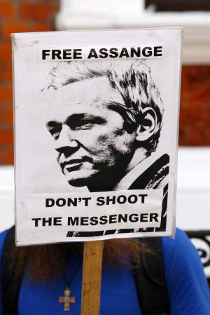 "A demonstrator protests outside the Ecuadorian embassy, London, Wednesday June 20, 2012. WikiLeaks founder Julian Assange entered the embassy Tuesday in an attempt to gain political asylum. Ecuador said Assange would ""remain at the embassy, under the protection of the Ecuadorean government"" while authorities in the capital, Quito, considered his case. Assange was arrested in London in December 2010 at Sweden's request. Since then he has been fighting extradition to the Scandinavian country, where he is wanted for questioning over alleged sexual assaults on two women in 2010. (AP Photo/Tim Hales)"