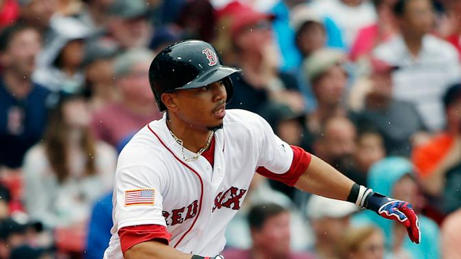 Boston Red Sox's Mookie Betts watches his one-run double during the eighth inning of a baseball game against the Houston Astros in Boston, Saturday, July 4, 2015. The Red Sox won 6-1. (AP Photo/Michael Dwyer)