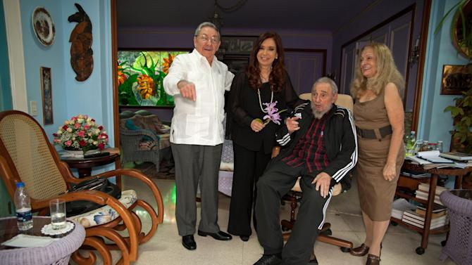 In this photo taken Jan.11, 2013, from left to right,  Cuba's President Raul Castro,  Argentina's President Cristina Fernandez,  Cuban leader Fidel Castro,  center, and Fidel's wife Dalia Soto del Valle pose for a photo after a private meeting in Havana, Cuba. Fernandez was in Cuba to visit Venezuela's President Hugo Chavez, who is recovering from cancer surgery.(AP Photo/Alex Castro)