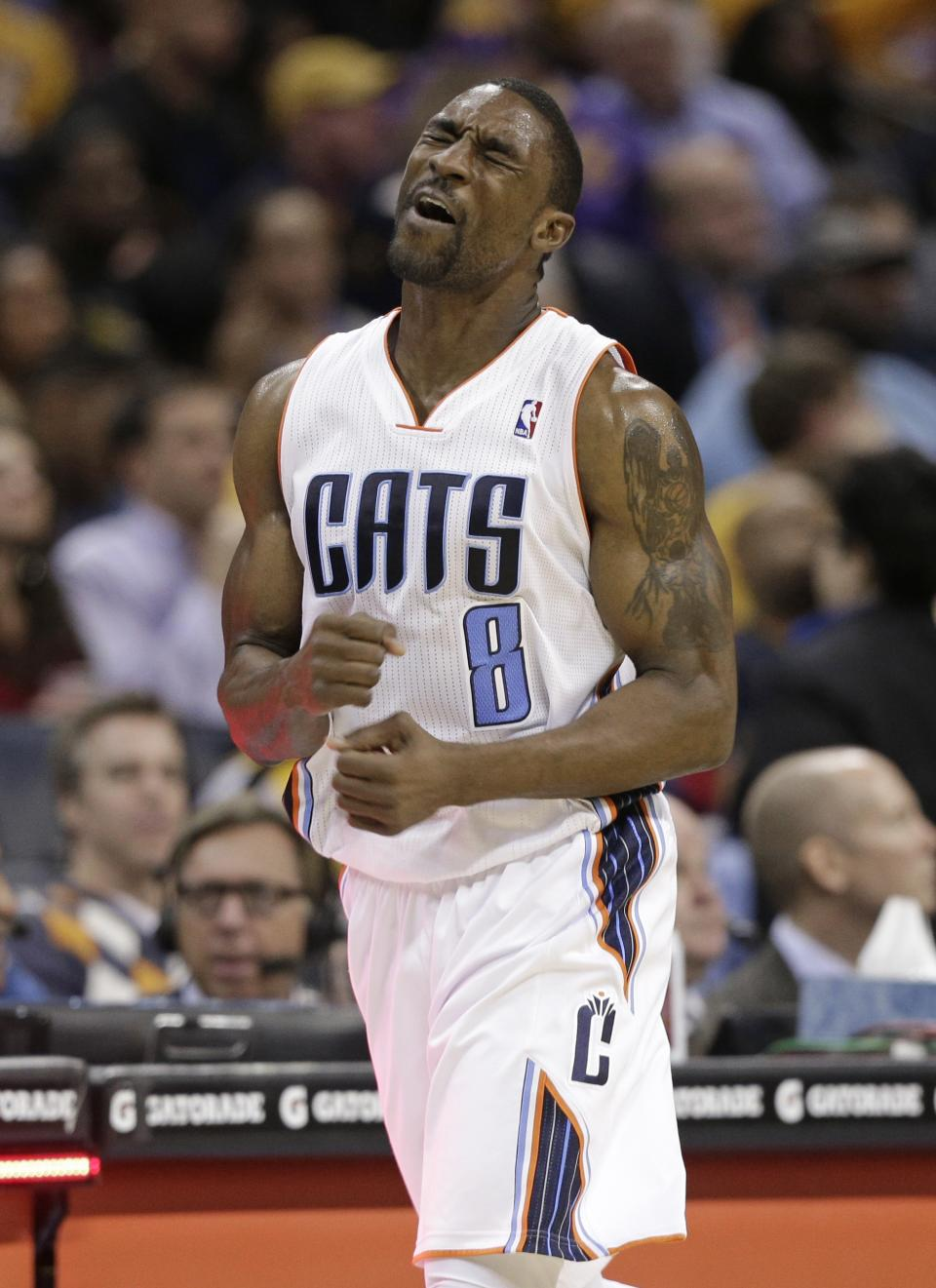 Charlotte Bobcats' Ben Gordon (8) reacts after a missed shot against the Los Angeles Lakers during the second half of an NBA basketball game in Charlotte, N.C., Friday, Feb. 8, 2013. The Lakers won 100-93. (AP Photo/Chuck Burton)