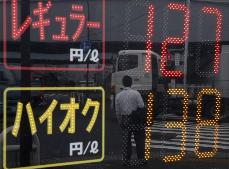Oil prices slide, supply overhang in focus