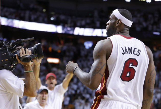 Miami Heat's James celebrates his game-winning shot against Indiana Pacers during of their NBA Eastern Conference final basketball playoff in Miami