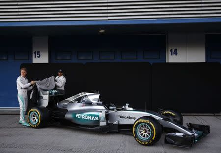 Mercedes Formula One racing driver Hamilton of Britain and teammate Rosberg of Germany unveil the new Mercedes F1 M06 car at the Jerez racetrack in southern Spain