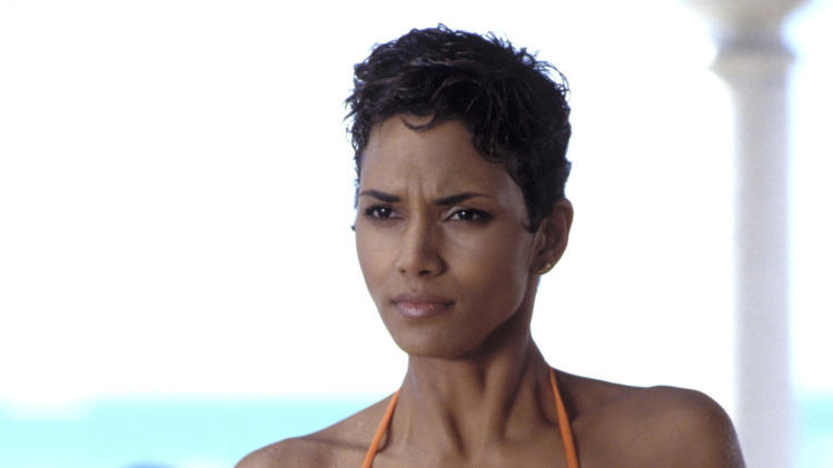"This undated publicity photo provided by United Artists and Danjaq, LLC shows Halle Berry in a scene from the James Bond 2002 film, ""Die Another Day."" Who qualifies as a Bond girl has also changed over the years, as the blue-eyed, buxom blonde has given way to more diverse leading ladies, including Michelle Yeoh (""Tomorrow Never Dies"") and Halle Berry (""Die Another Day""). Women use their presentation and their wiles to outsmart Bond. The film is included in the MGM and 20th Century Fox Home Entertainment Blu-Ray ""Bond 50"" anniversary set. (AP Photo/United Artists and Danjaq, LLC)"