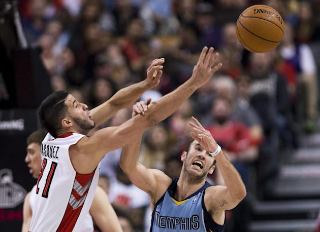 Toronto Raptors guard Greivis Vasquez, left, battles for the loose ball against Memphis Grizzlies guard Nick Calathes, right, during first half NBA basketball action in Toronto on Friday, March. 14, 2