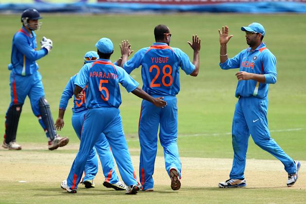 India A players celebrate after taking a wicket during the ODI match between India A and West Indies A at M Chinnaswamy Stadium, Bangalore on Sept. 17, 2013. (Photo: IANS)
