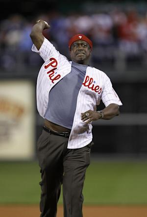FILE - In this Oct. 17, 2010 file photo, Gary Matthews throws out the ceremonial first pitch before Game 2 of baseball's National League Championship Series between the Philadelphia Phillies and the San Francisco Giants, in Philadelphia. Longtime Phillies broadcaster Chris Wheeler is out after nearly four decades in the booth and Gary Matthews isn't returning as color analyst, several people familiar with the situation told The Associated Press on Wednesday, Jan. 8, 2014. (AP Photo/Matt Slocum, File)