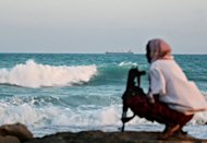 An armed Somali pirate keeping vigil on the coastline near Hobyo, northeastern Somalia, in 2010. A high-seas drama with Kalashnikov and rocket-propelled grenade fire gripped a Rome courtroom at the trial of alleged Somali pirates Tuesday, as EU forces blasted a pirate base for the first time.