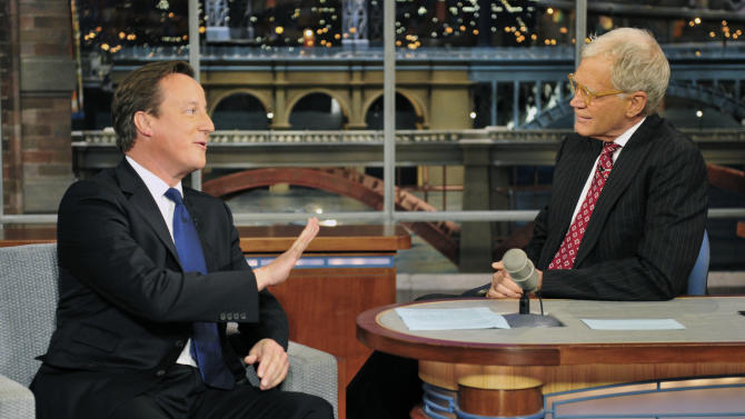 """In this photo provided by CBS, British Prime Minister David Cameron, left, talks with host David Letterman on the set of the """"Late Show with David Letterman,"""" Wednesday, Sept. 26, 2012 in New York. (AP Photo/CBS, John Paul Filo) MANDATORY CREDIT; NO ARCHIVE; NO SALES"""