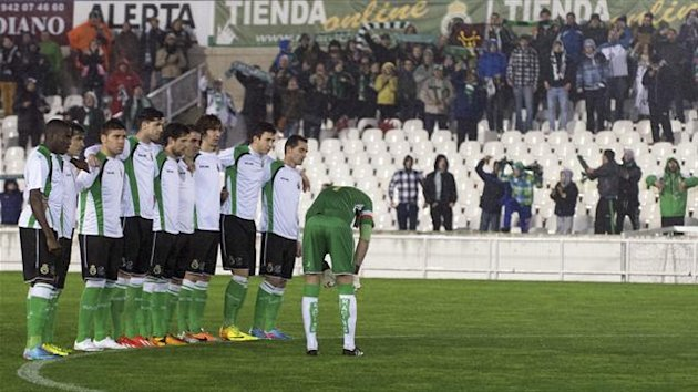 The referee blows his whistle to stop the match as Racing Santander players stand in a line and refuse to play at the start of their King's Cup quarter-final second leg against Real Sociedad in Santander, northern Spain, January 30, 2014 (Reuters)