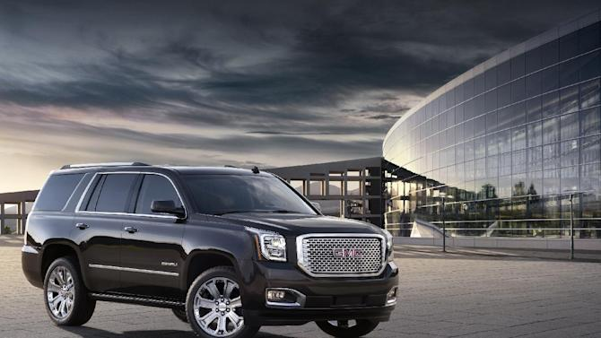 This undated photo provided by General Motors shows the 2015 GMC Yukon Denali. General Motors, which sells more SUVs than any other company, is unveiling a redesigned SUV lineup on Wednesday, Sept. 11, 2013. (AP Photo/General Motors)
