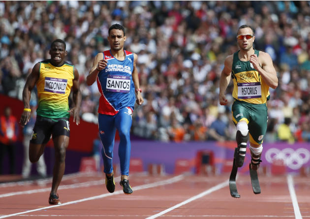 South Africa's Oscar Pistorius, Luguelin Santos of the Dominican Republic and Jamaica's Rusheen McDonald run in their men's 400m round 1 heat at the London 2012 Olympic Games