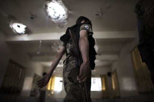 "<p>A Free Syria Army fighter walks inside a damaged mosque in the Old City of Aleppo. Serious human rights violations have soared dramatically in Syria, a top UN investigator said Monday, calling for ""appropriate action"" against perpetrators of atrocities in the wartorn country.</p>"