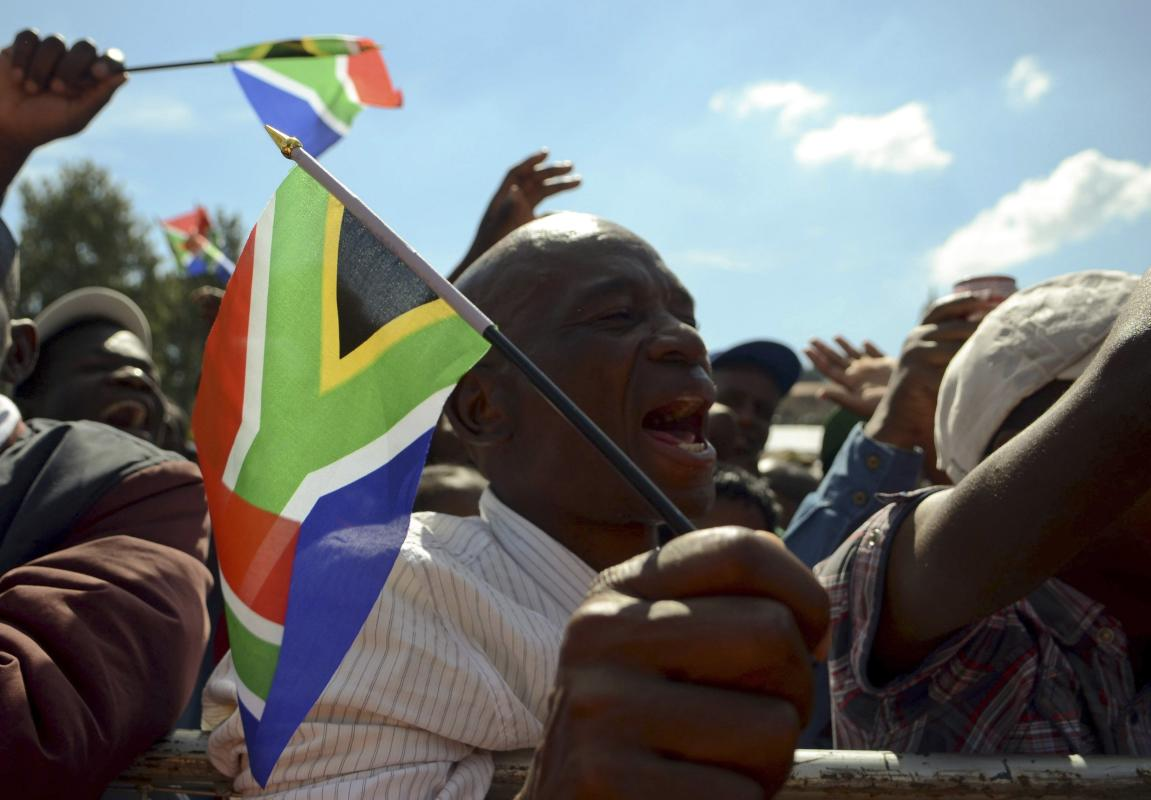 A man cheers and waves a flag during Freedom Day celebrations in Pretoria