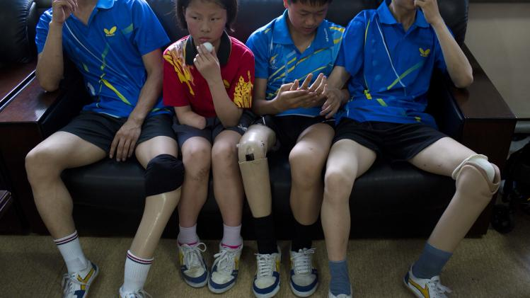 FILE -  In this June 13, 2012 photo, disabled North Korean table tennis players rest during practice at the Taedonggong Cultural Center for the Disabled in Pyongyang, North Korea. North Korea, long accused of shunting its disabled residents off to isolated detention camps, will take part for the first time this year in the Paralympics, which open Wednesday, Aug. 29 in London. (AP Photo/David Guttenfelder, File)
