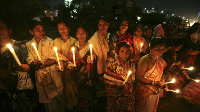Indian women hold candles as they participate in a silent protest rally in the eastern Indian city Bhubaneswar, India, Thursday, Dec. 20, 2012. The hours-long gang-rape and near-fatal beating of a 23-year-old student on a bus in New Delhi triggered outrage and anger across the country as Indians demanded action from authorities who have long ignored persistent violence and harassment against women. (AP Photo/Biswaranjan Rout)