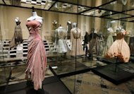 A dress by French designer Madame Gres (L) is displayed in the storage of the Galliera fashion museum in Paris, on February 25, 2013. A landmark exhibition due to open in Paris on Saturday traces the history of haute couture through some of the most exquisite dresses ever made