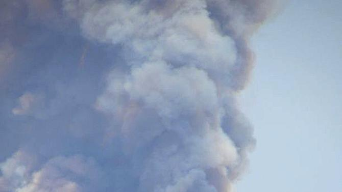This photo provided by InciWeb Incident Information System shows the Whitewater-Baldy Complex fire in Mogollon, N.M., a privately owned ghost town which was ordered to evacuate. Fire officials in New Mexico said Saturday, May 26, 2012, that the blaze has shrunk slightly to 82,000 acres but is still 0 percent contained because of weather conditions. (AP Photo/InciWeb Incident Information System)