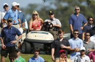 Skier Lindsey Vonn, girlfriend of Tiger Woods, sits in a golf cart watching the final round of The Players Championship PGA golf tournament at TPC Sawgrass in Ponte Vedra Beach, Florida May 12, 2013. REUTERS/Chris Keane (UNITED STATES  - Tags: SPORT GOLF)