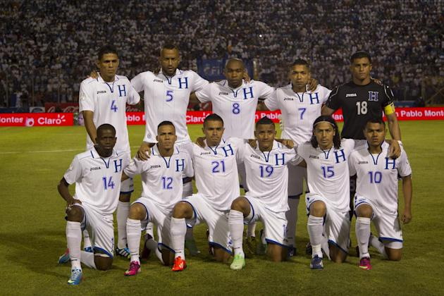 FILE- In this June 11, 2013 file photo, Honduras national soccer team poses prior to the start the 2014 World Cup qualifying soccer match between Honduras and Jamaica in Tegucigalpa, Honduras. Backgro