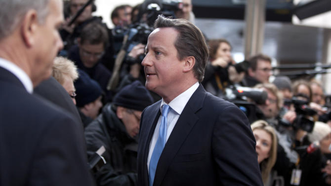 Cameron confronts opposition over media regulation