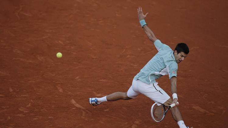Serbia's Novak Djokovic returns against Bulgaria's Grigor Dimitrov in their third round match at the French Open tennis tournament, at Roland Garros stadium in Paris, Saturday, June 1, 2013. Djokovic won in three sets. (AP Photo/Michel Spingler)