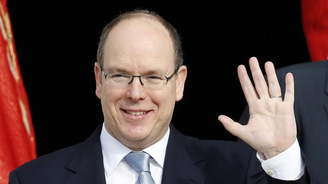 Prince Albert II of Monaco waves as he leaves Monaco's Cathedral following a mass for the traditional Sainte Devote celebration in Monaco