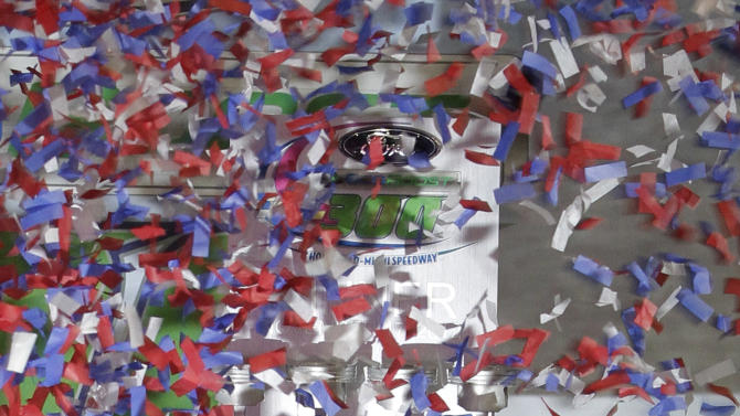 Driver Regan Smith holds up the trophy as he celebrates in victory lane after winning the NASCAR Nationwide Series auto race at Homestead-Miami Speedway Saturday, Nov. 17, 2012 in Homestead, Fla.  (AP Photo/Alan Diaz)