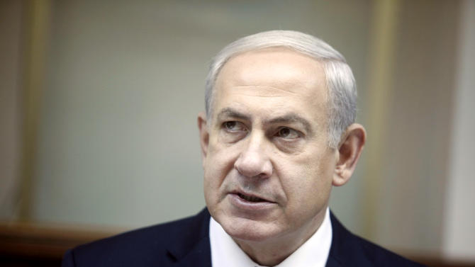 Israeli Prime Minister Benjamin Netanyahu heads the weekly cabinet meeting in his Jerusalem office, Sunday, Oct. 21, 2012. Netanyahu is vowing to continue building in east Jerusalem, over the objection of Palestinians who claim the territory as capital of their hoped-for state. (AP Photo/Lior Mizrahi, Pool)
