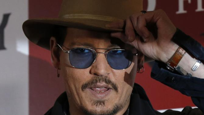 "Actor Johnny Depp poses during a photo session ahead of a news conference for his movie ""Mortdecai"" in Tokyo"