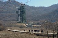 North Korean officials and journalists leave the launch pad after a visit to Tangachai -ri space center in April. North Korea has undertaken a major upgrade of another launch pad that could pave the way for longer-range missiles, a research group said