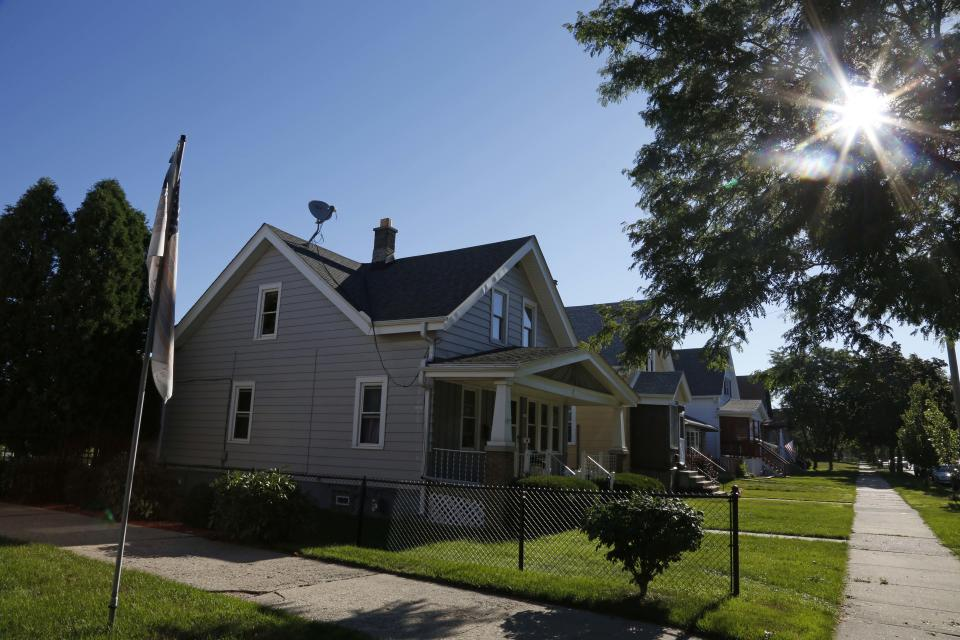 This Monday, Aug. 6, 2012 photo shows a duplex home in Cudahy, Wis. where Sikh Temple of Wisconsin shooting suspect, Wade Michael Page, lived upstairs. (AP Photo/Jeffrey Phelps)